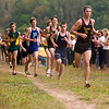 Record-Eagle/Jan-Michael Stump<br /> Traverse City Central's Evan Cover leads a pack of runners in the Traverse City West Cross Country Invitational Tuesday at Hickory Meadows. Cover would go on to win with a time of 17:29.