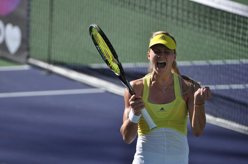 Maria Kirilenko shows some excitement after her win