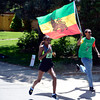 Ethiopia's picks up a flag waving fan as she wins theWomen's International Team Challenge during the 2012 Bolder Boulder in Boulder, Colorado May 28, 2012. CAMERA/MARK LEFFINGWELL