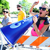 Julie Rowan cheers on the runners during the Citizen's Race of  the 2012 Bolder Boulder.<br /> Photo by Paul Aiken / The Camera