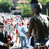 Ben Holmes of the Centennial State Pipe and Drums plays before the Frank Shorter statue during the Citizen's Race of  the 2012 Bolder Boulder.<br /> Photo by Paul Aiken / The Camera
