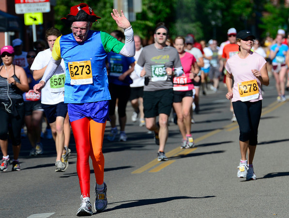 Robert Fowler waves to the crowd during the 2012 Bolder Boulder in Boulder, Colorado May 28, 2012. CAMERA/MARK LEFFINGWELL