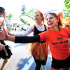 Wendi Friesen, left, and Karin Linner cheer on the runners during the Citizen's Race of  the 2012 Bolder Boulder.<br /> Photo by Paul Aiken / The Camera