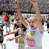"Danielle McAvoy, of Louisville, left, and Remi Divine Divine scream as they cross the finish line of the Bolder Boulder on Monday, May 28. For more photos of the race go to  <a href=""http://www.dailycamera.com"">http://www.dailycamera.com</a><br /> Jeremy Papasso/ Camera"