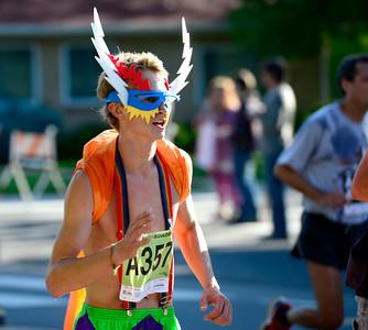 Jon Johannsen runs like a super hero during the 2012 Bolder Boulder in Boulder, Colorado May 28, 2012. CAMERA/MARK LEFFINGWELL