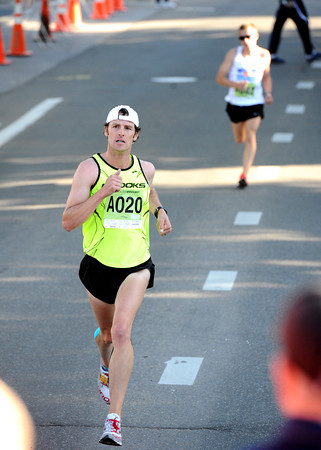 Josh Eberly pulls away from Curtis Begley Jr,  in the Citizen's Race during the  2012 Bolder Boulder.<br /> Photo by Paul Aiken / The CameraCitizen's Race during the  2012 Bolder Boulder.<br /> Photo by Paul Aiken / The Camera
