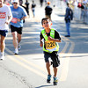 Santiago Renteria of Grand Junction, Colorado struggles up the final hill to Folsom Field during the Citizen's Race of  the 2012 Bolder Boulder.<br /> Photo by Paul Aiken / The Camera