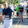 Scott Romney of Provo, Utah works to get up the last hill to Folsom Field during the Citizen's Race of  the 2012 Bolder Boulder.<br /> Photo by Paul Aiken / The Camera
