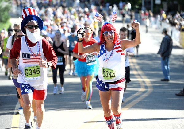 James and Zayra Garrison of Colorado Springs, are decked out in red white and blue during the Citizen's Race of  the 2012 Bolder Boulder.<br /> Photo by Paul Aiken / The Camera