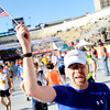"Bill Tongue, of Colorado Springs, holds an American flag after crossing the finish line inside Folsom Field on the University of Colorado campus on Monday, May 28, during the Bolder Boulder citizens race in Boulder, Colo. For more photos of the race go to  <a href=""http://www.dailycamera.com"">http://www.dailycamera.com</a><br /> Jeremy Papasso/ Camera"