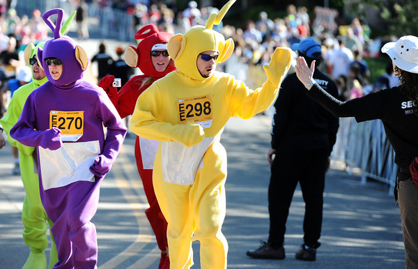 David Bunker, left, and Richard Poppe both of North Platte, Nebraska run in costumes during the Citizen's Race of  the 2012 Bolder Boulder.<br /> Photo by Paul Aiken / The Camera