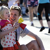 0528BBML6.jpg Huybert Groenendaal and his daughter, Violet, cheer the runners as they pass during the 2012 Bolder Boulder in Boulder, Colorado May 11, 2012. CAMERA/ MARK Leffingwell
