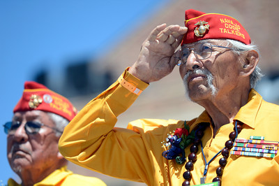 World War II veterans and Navajo Code Talkers Bill Toledo, left, and Albert Smith salute the crowd after being honored at the finish line of the Bolder Boulder inside Folsom Field during the Memorial Day tribute on Monday, May 28. For more photos of the race go to www.dailycamera.com Jeremy Papasso/ Camera