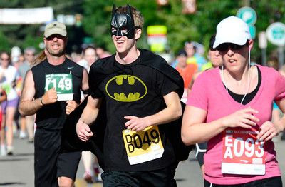Jeff Baines runs the race in his Batman suit during the 2012 Bolder Boulder in Boulder, Colorado May 28, 2012. CAMERA/MARK LEFFINGWELL
