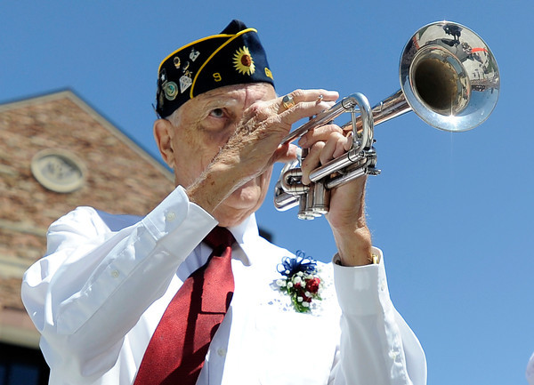 "World War II veteran Stewart Boone plays TAPS with his trumpet during a memorial day tribute at the finish line of the Bolder Boulder on Monday, May 28. For more photos of the race go to  <a href=""http://www.dailycamera.com"">http://www.dailycamera.com</a><br /> Jeremy Papasso/ Camera"