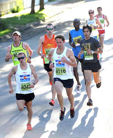 Curtis Begley Jr duels with Joshua Glaab early in the Citizen's Race during the  2012 Bolder Boulder.<br /> Photo by Paul Aiken / The Camera