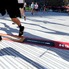"Racers and their shadows cross the finish line inside Folsom Field on the University of Colorado campus on Monday, May 28, during the Bolder Boulder race in Boulder, Colo. For more photos of the race go to  <a href=""http://www.dailycamera.com"">http://www.dailycamera.com</a><br /> Jeremy Papasso/ Camera"