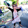 Meghan Robertie hula hoops while cheering on the runners during the Citizen's Race of  the 2012 Bolder Boulder.<br /> Photo by Paul Aiken / The Camera