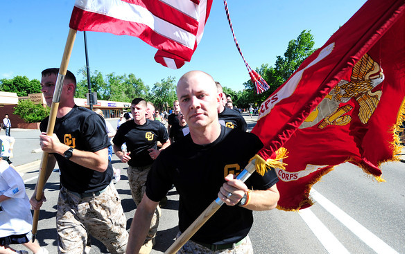 Michael McBride carries the Marine Corps flag during the Citizen's Race of  the 2012 Bolder Boulder.<br /> Photo by Paul Aiken / The Camera