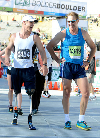 "Kevin Lunn, left, and Shawn Scholl share a laugh at the finish line inside Folsom Field on the University of Colorado campus on Monday, May 28, during the Bolder Boulder race in Boulder, Colo. For more photos of the race go to  <a href=""http://www.dailycamera.com"">http://www.dailycamera.com</a><br /> Jeremy Papasso/ Camera"