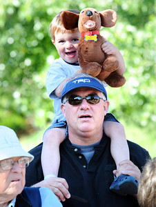 Jack Davis, 3, and his dad Tyler wait and watch for Jack's mom Michelle during the Citizen's Race of  the 2012 Bolder Boulder. Photo by Paul Aiken / The Camera