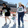 "Angie Nevarez, of New York, left, and two other unidentified runners cross the finish line of the Bolder Boulder on Monday, May 28. For more photos of the race go to  <a href=""http://www.dailycamera.com"">http://www.dailycamera.com</a><br /> Jeremy Papasso/ Camera"