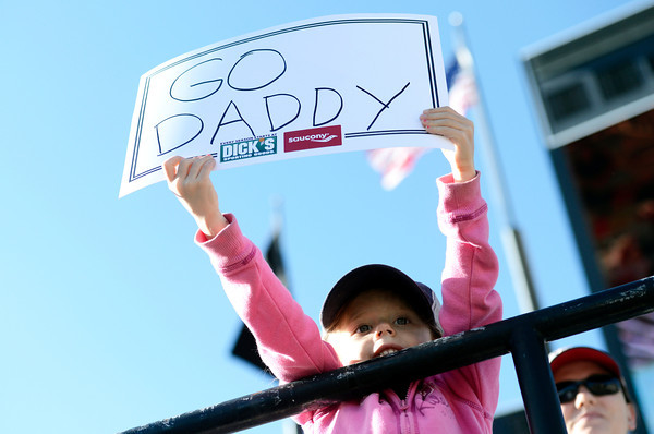 "Cailyn Baldermann, 4, holds up a sign supporting her father Kevin Baldermann as he crosses the finish line inside Folsom Field on the University of Colorado campus on Monday, May 28, during the Bolder Boulder race in Boulder, Colo. For more photos of the race go to  <a href=""http://www.dailycamera.com"">http://www.dailycamera.com</a><br /> Jeremy Papasso/ Camera"