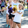 Frannie Yee, front, and Nora O'Neill of the Boulder High Poms cheer on the runner during the Citizen's Race of  the 2012 Bolder Boulder.<br /> Photo by Paul Aiken / The Camera