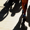 "Runners cast a shadow as they finish and leave Folsom Filed on Monday.<br /> For more photos and videos of the 34th Bolder Boulder, go to  <a href=""http://www.dailycamera.com"">http://www.dailycamera.com</a>.<br /> Cliff Grassmick / May 28, 2012"