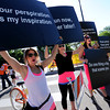 "Stephanie Christensen, left, Sara Laakso, and Devon Craig, provide inspiration to the runners on Walnut Street.<br /> For more photos and videos of the 34th Bolder Boulder, go to  <a href=""http://www.dailycamera.com"">http://www.dailycamera.com</a>.<br /> Cliff Grassmick / May 28, 2012"