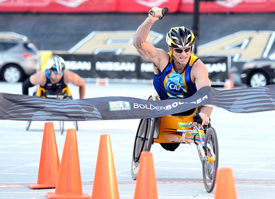 Scott Parson, of San Jose, Cali., raises his hand in victory after crossing the finish line inside Folsom Field in first place during professional wheelchair race at the Bolder Boulder on Monday, May 28, in Boulder, Colo. For more photos of the race go to www.dailycamera.com Jeremy Papasso/ Camera