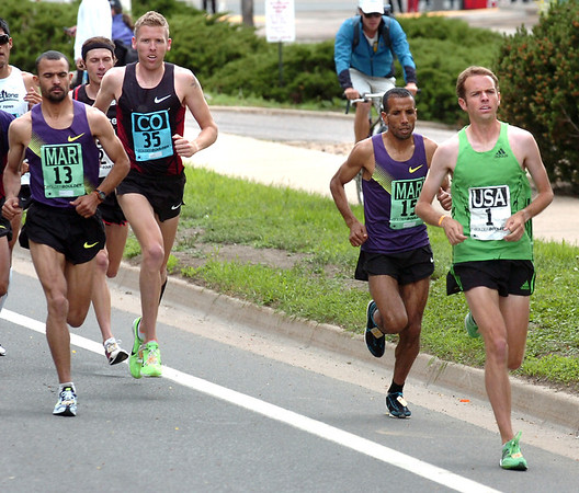 Aaron Braun of Team USA, at right leads a group of runners including from left to right Hicham Bellani, Jason Hartmann, and Abdellah Falil during the 2011 Men's Elite Race<br /> Photo by Paul Aiken