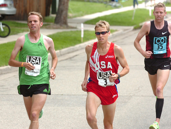 "From left to right Aaron Braun, Ryan Hall of team USA and Jason Hartmann of Team Colorado during the 2011 Bolder Boulder Elite Men's race.<br /> For more photos and videos go to  <a href=""http://www.dailycamera.com"">http://www.dailycamera.com</a><br /> Photo by Paul Aiken  / The Boulder Camera"