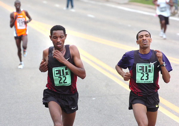 "Belete Assefa, left and Solomon Gonfa run away from the field near the end of the Men's Elite 2011 Bolder Boulder course.<br /> For more photos and videos go to  <a href=""http://www.dailycamera.com"">http://www.dailycamera.com</a><br /> Photo by Paul Aiken  / The Boulder Camera"