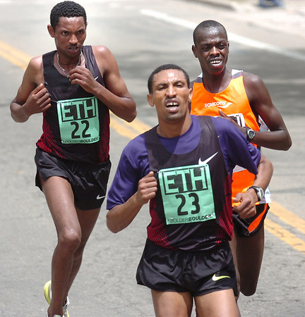 "From left to right Belete Assefa and Solomon Gonfa of Ethiopia battle with Allan Kiprono of Kenya near the end of the Men's Elite 2011 Bolder Boulder course.<br /> For more photos and videos go to  <a href=""http://www.dailycamera.com"">http://www.dailycamera.com</a><br /> Photo by Paul Aiken  / The Boulder Camera"