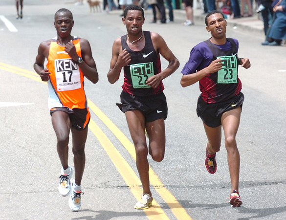 "From left to right Allan Kiprono of Kenya, Belete Assefa and Solomon Gonfa of Ethiopia battle near the end of the Men's Elite 2011 Bolder Boulder course.<br /> For more photos and videos go to  <a href=""http://www.dailycamera.com"">http://www.dailycamera.com</a><br /> Photo by Paul Aiken  / The Boulder Camera"