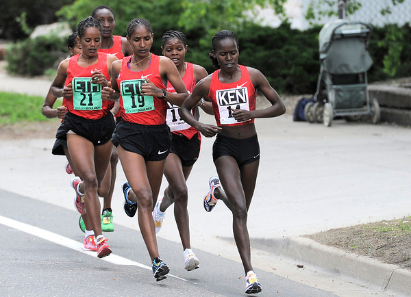 Team Kenya and Team Ethiopia start the race in a tight pack during the Bolder Boulder in Boulder, Colorado May 30, 2011.  CAMERA/Mark Leffingwell