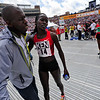 BOLDER<br /> Lineth Chepkurui of Kenya, who won the women's pro race at the 2011 Bolder Boulder, is hugged by Peter Tamur. <br /> Photo by Marty Caivano/May 30, 2011