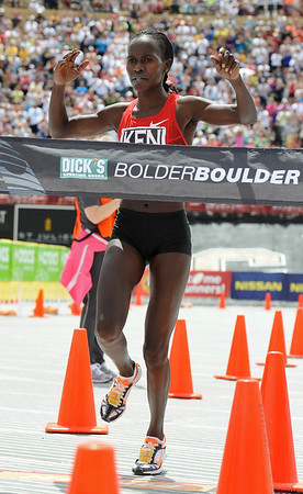 BOLDER<br /> Kenya's Lineth Chepkurui wins the women's elite race at the 2011 Bolder Boulder. <br /> Photo by Marty Caivano/May 30, 2011