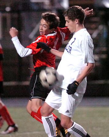 Fairview's #9 Bryan Windsor battles Boulder's #7 Will Maxwell for the ball during their playoff game at Recht Field Boulder on November 2, 2010. <br /> Paul Aiken / The Camera