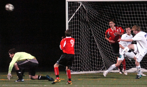 Boulder's #22 Russell Werner clears the ball from the front of the net  at Recht Field Boulder on November 2, 2010. <br /> Paul Aiken / The Camera