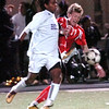 Boulder's #10 Brook Assefa battle Fairview's #11 Eric Kronenberg for the ball at Recht Field Boulder on November 2, 2010. <br /> Paul Aiken / The Camera