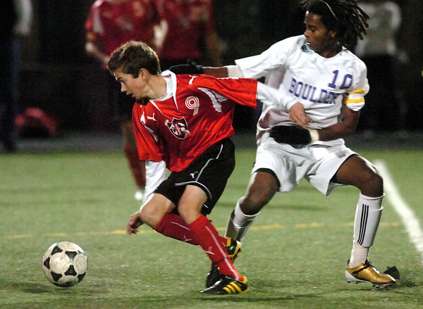 Fairview's #9 Bryan Windsor tries to control the ball against Boulder High's #10 Brook Assefa during their playoff game at Recht Field Boulder on November 2, 2010. <br /> Paul Aiken / The Camera
