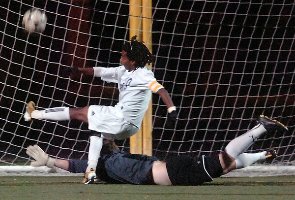 Boulder's #10 Brook Assefa drives the ball into the net over Philip Killenn for his teams' first goal against Fairview  at Recht Field Boulder on November 2, 2010. <br /> Paul Aiken / The Camera