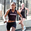 Deaydrah Williams of Boulder High School pulls away from the field during their track meet against Fairview High School at Recht Field on the Boulder High School Campus on Wednesday March 16, 2011<br /> Photo by Paul Aiken / The Camera