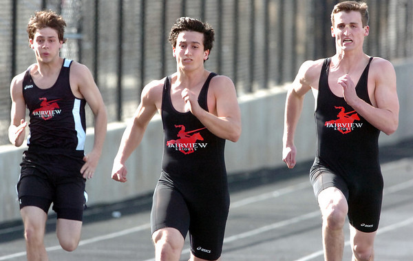 From left to right Joris Van Zeghbroeck, Ben Meyers and Josh Hill of Fairview High run side by side in the 100 Meter Dash during their track meet against Boulder High School at Recht Field on the Boulder High School Campus on Wednesday March 16, 2011<br /> Photo by Paul Aiken / The Camera