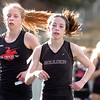 Kristen Narum, left of Fairview runs just off the shoulder of Erin McLaughlin of Boulder High during their meed at Recht Field on the Boulder High School Campus on Wednesday March 16, 2011<br /> Photo by Paul Aiken / The Camera