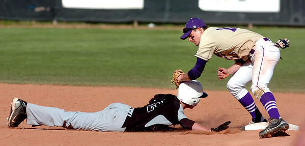 Monarch's #2 Isaac Spence gets picked off second base by <br /> #16 Sean Sredojevic during the game of Boulder High School against Monarch High School at Scott Carpenter Park  on Tuesday, May 3, 2010.<br /> Paul Aiken / The Camera