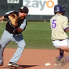 Boulder's #5 Chris Bremner steals second safely as Monarch's <br /> #1 Ignacio Branger during the game of Boulder High School against Monarch High School at Scott Carpenter Park  on Tuesday, May 3, 2010.<br /> Paul Aiken / The Camera