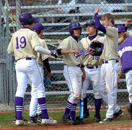 Boulder High School's #19 John Crook is congratulated by teammates after  his 3 run home run  against Poudre High School at Scott Carpenter Park on Thursday April 22, 2010.<br /> Photo by Paul Aiken / The Camera /